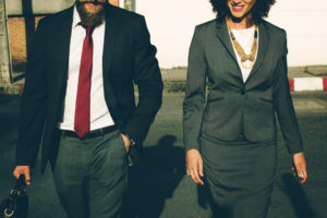 A man and woman dressed for work