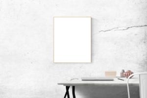 A empty photo frame on a plain wall