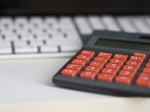 calculator by laptop
