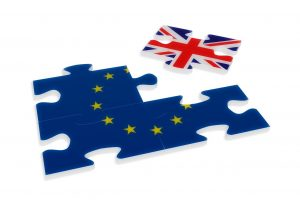 puzzle pieces with EU and British flag on