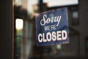 sorry we're closed door sign