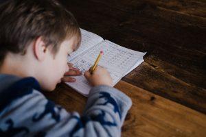 Child at desk doing his homework